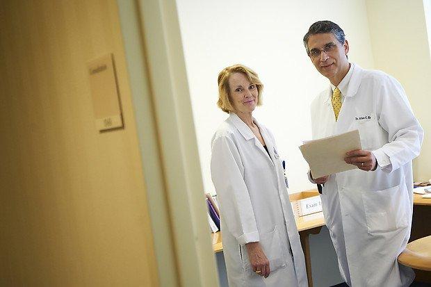 MSK melanoma staging expert, Allan Halpern and dermatology nurse Nancy Eastman smiling at the camera
