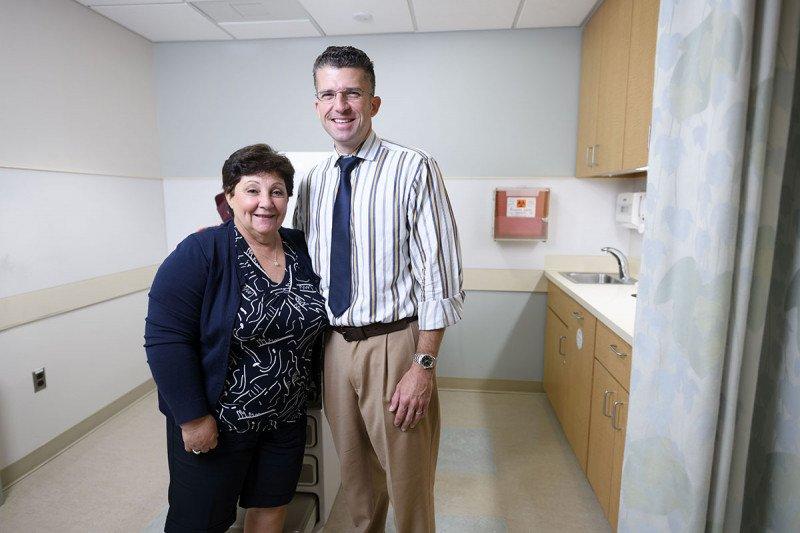 Melanoma specialist Christopher Barker hugging a patient