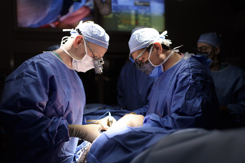 surgeons operating on patient