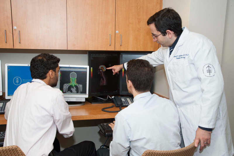 Residents Sam Bakhoum, Erik Anderson, and Suchit Patel review the radiology on an inpatient case.