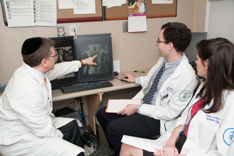 Radiation oncologist Michael Zelefsky (left) reviews a patient's prostate MRI with residents Robert Samstein and Natalie Lockney.