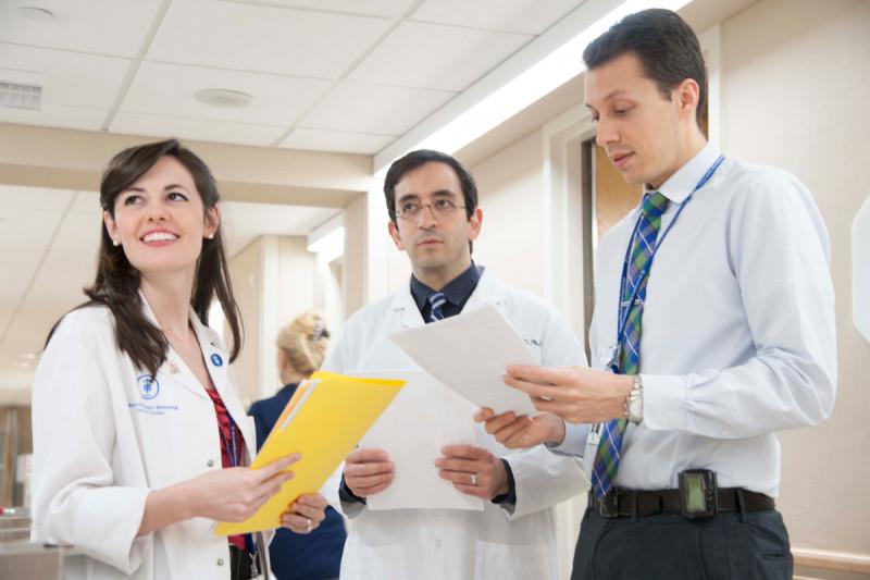 Residents Natalie Lockney, Sam Bakhoum, and Erik Anderson review patient notes.