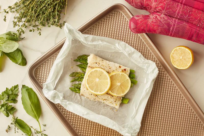 Fish, asparagus, and lemon on a plate