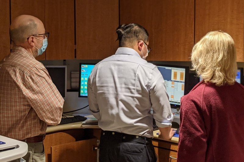 Warren Fong, M.S. with Dr. Michael Lovelock at Varian Truebeam console