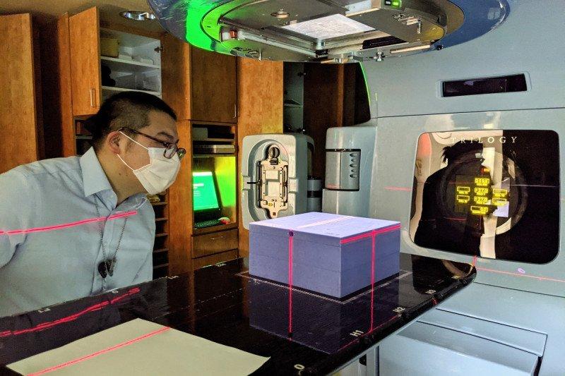 Warren Fong, M.S. setting up solid water phantom