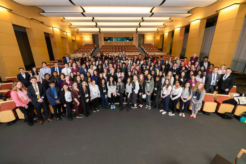 a large group of students and teachers