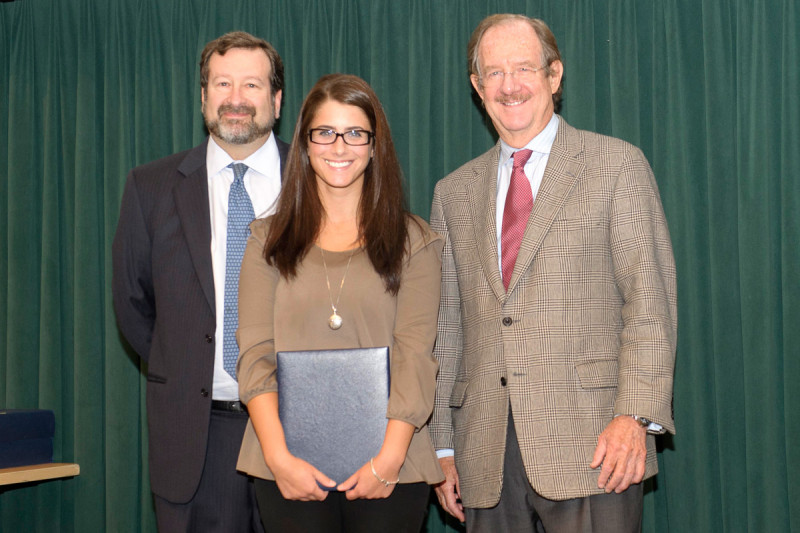 Emily Casey receives the 2012 Geoffrey Beene Graduate Student Fellowship award from Thomas Kelly, alongside her mentor David Scheinberg.