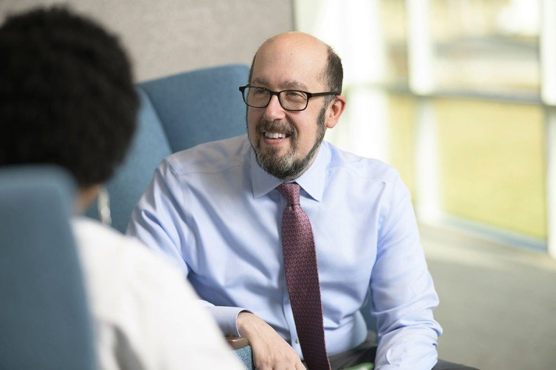 Matthew Matasar, medical director at MSK Bergen, smiles while talking with a colleague.