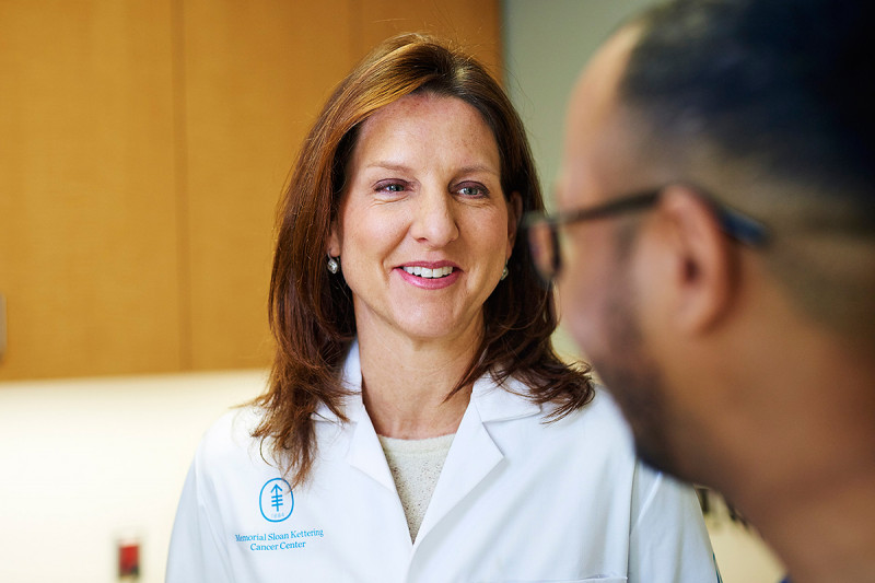 MSK Radiation Oncologist, Kathryn Beal, smiles at patient.