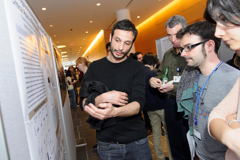 "Federico Gonzalez Grassi (left) of the Sloan Kettering Institute's Developmental Biology Program and the Center for Stem Cell Biology NYSTEM Trainings Grant discusses ""Homologous Recombination DNA Repair Genes Play a Critical Role in Reprogramming to a Pluripotent State."""