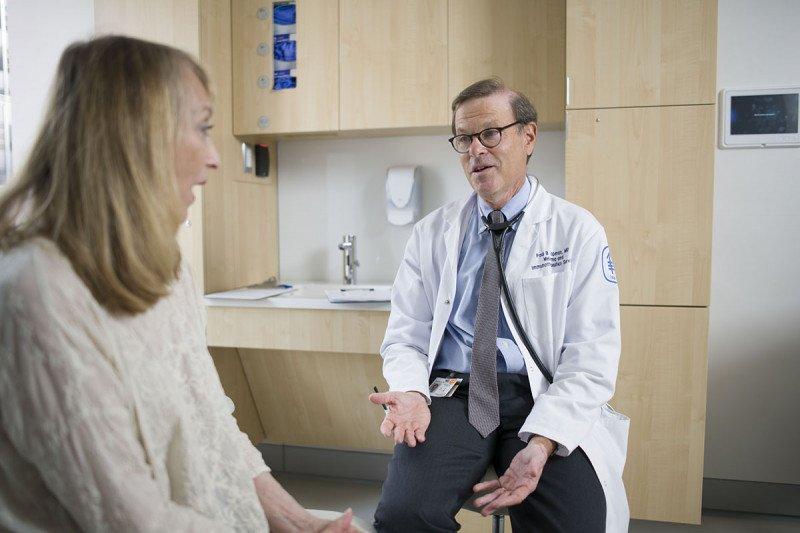 Paul Chapman with a patient