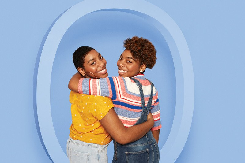 Two teenage girls with their arms around each other