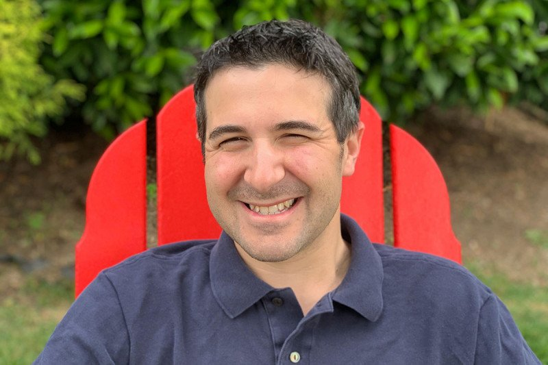 Seth Frankel sitting in a red chair