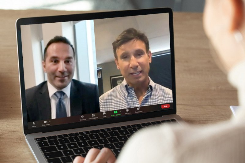 Medical oncologist Oscar Lahoud speaks with a patient via Zoom session