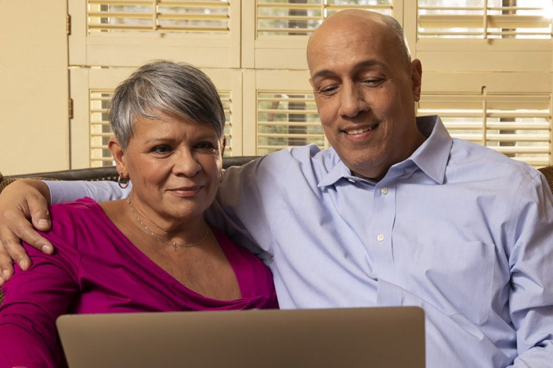 Couple looking at laptop screen together