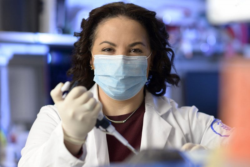 Physician-scientist Allison Betof Warner working in the lab.