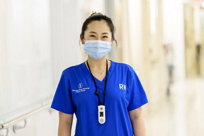 Minhyeung Kim, RN, poses inside the hospital.
