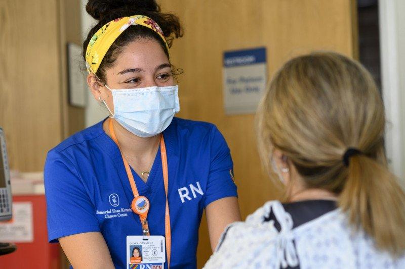 Clinical Nurse Sarah Olaya speaks with a patient.