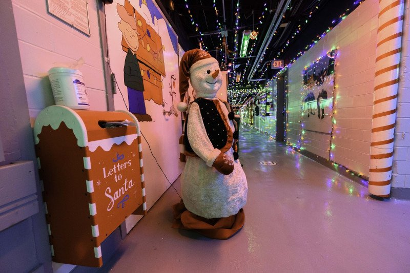 Frosty the Snowman keeps watch over Letters to Santa in MSK's Holiday Hallway.