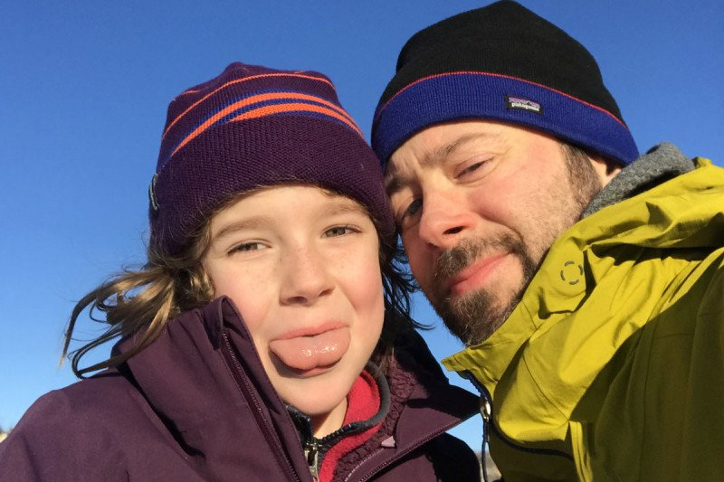 Damien Scogin is seen outdoors with his 9-year-old daughter, Jane. Damien is being treated at MSK's Center for Young Onset Colorectal and Gastrointestinal Cancer, the first center in the world devoted to people under 50 with these types of cancer.