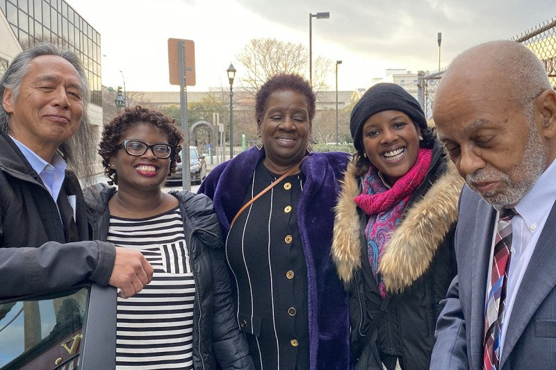 (Left to right: Ronald McNeil, Joseph McNeil's son; Claris Smith, Dr. Smith's sister; Barbara Smith, Mr. McNeil's cousin and Dr. Smith's mother; Dr. Melody Smith; Joseph McNeil)