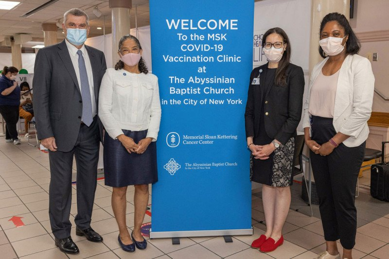 Craig Thompson, Carol Brown, Yadira Rosemin, and Maurisha Osi posing for a photo next to an MSK sign