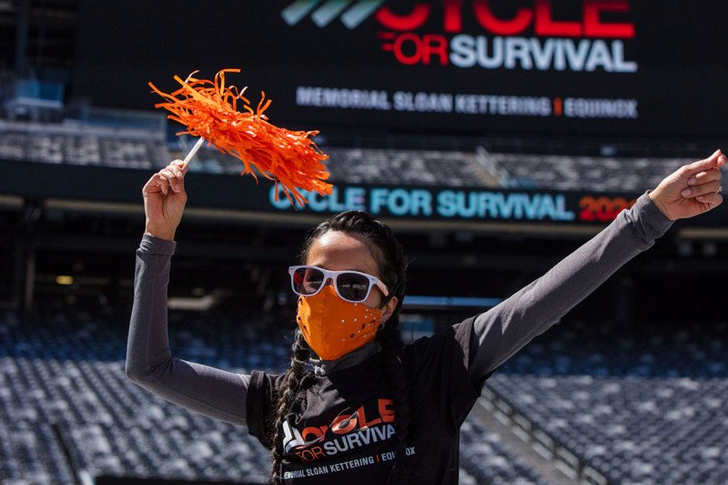 Woman with a pom pom at the Cycle for Survival event at MetLife Stadium