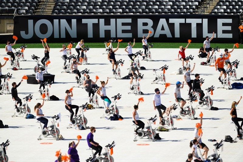 A crowd of people on stationary bicycles at the Cycle for Survival event at MetLife Stadium