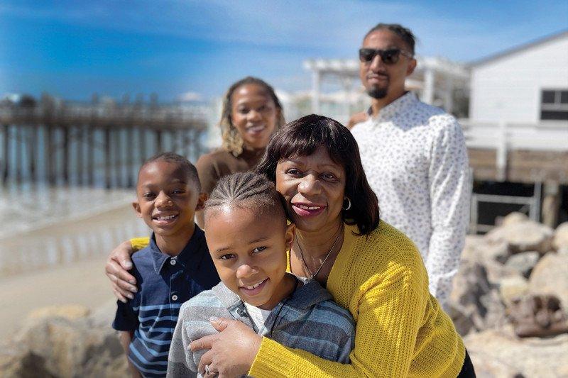 Ilene Thompson with her family on the beach