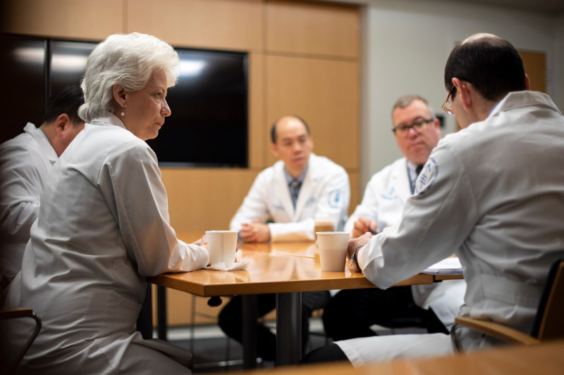 Urologic surgeon Machele Donat at a table with other physicians