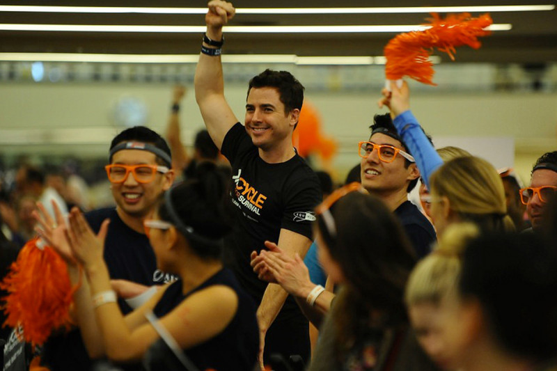 Equinox cycling instructor Justin Rubin motivates riders in Los Angeles. Equinox is the founding partner of Cycle for Survival and its instructors lead every ride. This year, Equinox employees also led more than 100 teams from coast to coast.