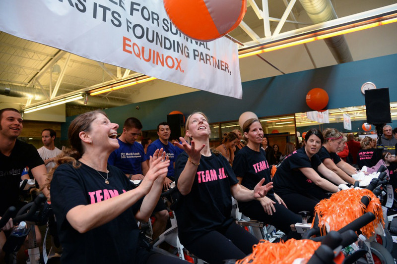 "Participants from ""Team Jill"" pass around a Cycle for Survival beach ball before their ride starts in Summit, New Jersey."