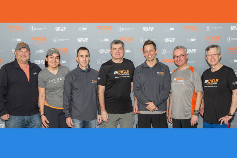 Late Night host and longtime Cycle for Survival supporter Seth Meyers with Memorial Sloan Kettering and Equinox leadership (from left): Scott Rosen, Equinox Chief Operating Officer; Sarah Robb O'Hagan, Equinox President; Harvey Spevak, Equinox CEO; Craig Thompson, MSK President and CEO; Mr. Meyers; José Baselga, MSK Physician-in-Chief; and Joan Massagué, Director of the Sloan Kettering Institute.