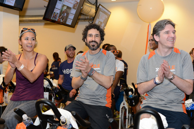 Survivor winner and rare-cancer survivor Ethan Zohn (center) rides next to Miguel Perales (right) in San Francisco. Dr. Perales is Deputy Chief of the Adult Bone Marrow Transplant Service at Memorial Sloan Kettering and treated Mr. Zohn, who was diagnosed with lymphoma in 2009.
