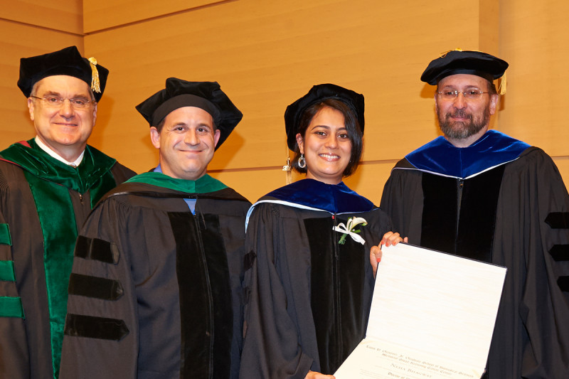 <em>(From left)</em> President and CEO Craig Thompson, physician-scientist Ross Levine, GSK graduate Neha Bhagwat, and GSK Dean Kenneth Marians