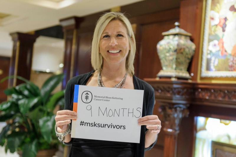 MSK survivor Anita displays her survivorship milestone at our Long Island celebration.