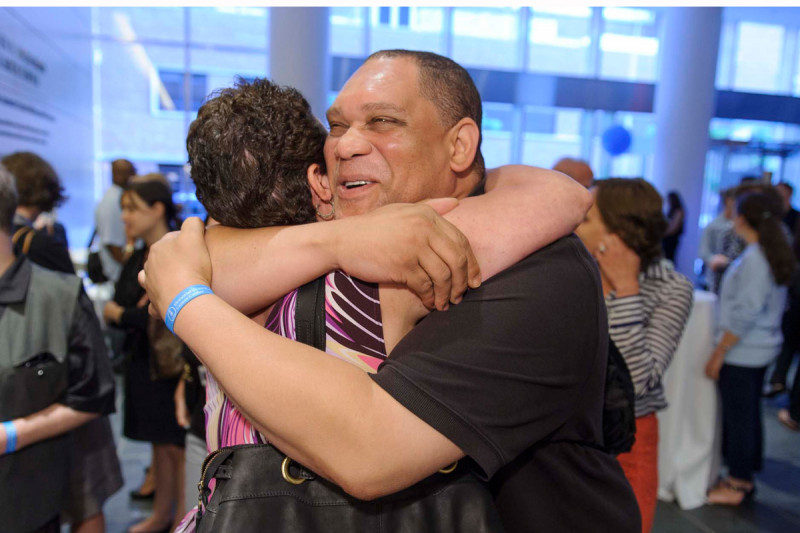 Nick Medley, a cancer survivor and concierge at MSK's 53rd Street facility, greets a friend during a reception at our Manhattan event.