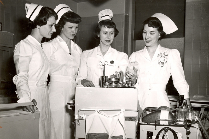 Then: Nurses demonstrate a mobile unit for emergency patient treatment at the bedside.