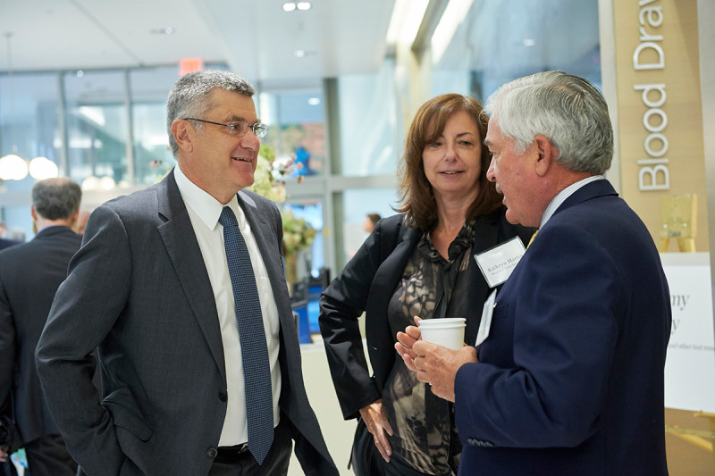 Louis V. Gerstner, Jr., Honorary Chair of MSK's Boards, chatted with President Thompson and Executive Vice President and Chief Hospital Operating Officer Kathryn Martin during a reception following the ribbon cutting.