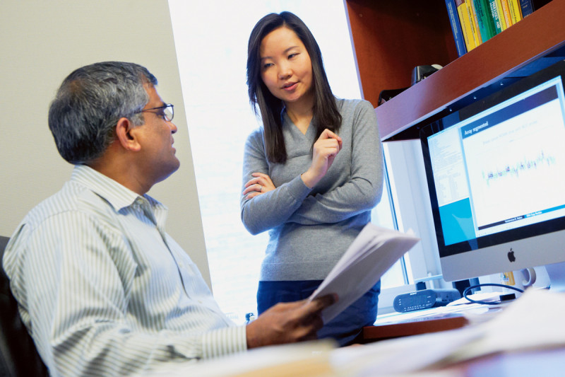 Pictured: Biostatisticians Venkatraman Seshan (left) and Ronglai Shen use computational methods to analyze cancer genome data.