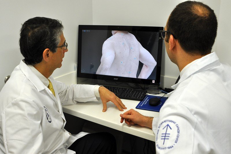Pictured: Two doctors look at a computer screen showing a 3-D image of a patient.