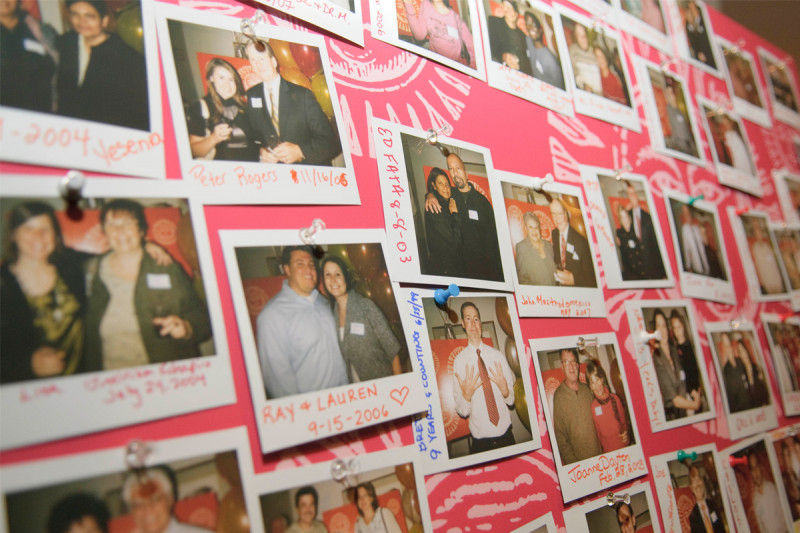 Photos of transplant survivors attending the party are on display