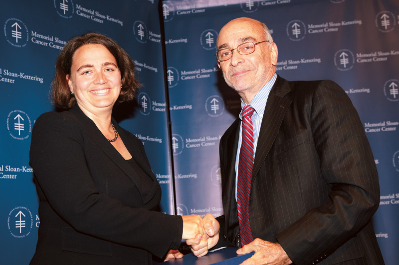 Memorial Sloan Kettering Physician-in-Chief Robert Wittes presents Memorial Sloan Kettering surgeon Larissa Temple with the Boyer Clinical Research Award