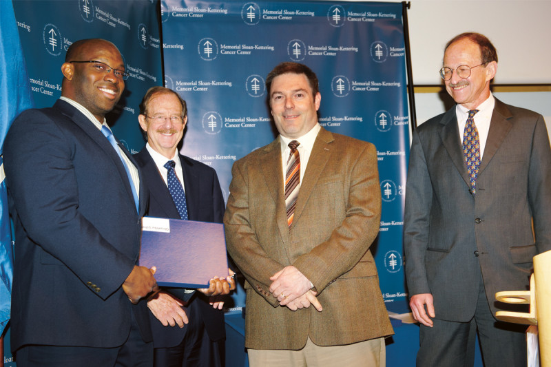 (From left) PhD recipient Olimsambu Uche, SKI Director Thomas Kelly, and faculty mentor Derek Sant'Angelo