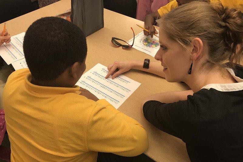 A postdoc mentors a student