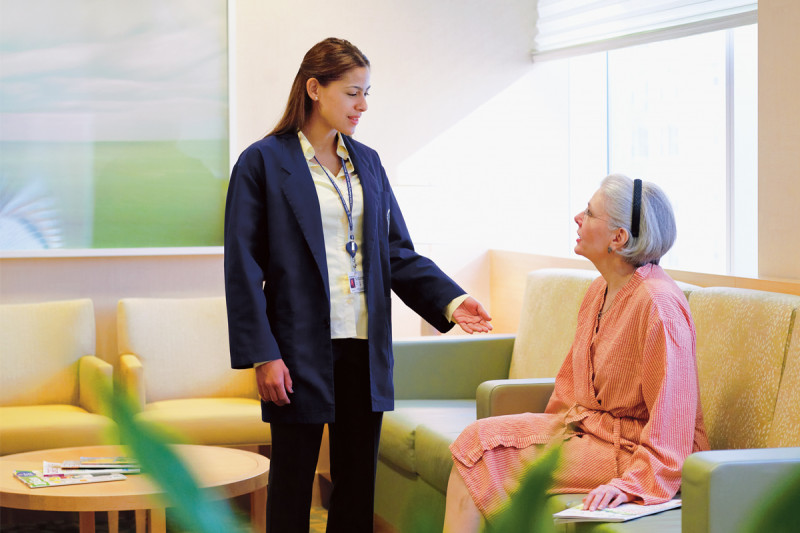 Patient waiting rooms are separated from public reception areas, affording patients an added degree of privacy. Session assistants (one is pictured above, in the blue jacket) escort patients to and from their appointments in the breast and imaging center.