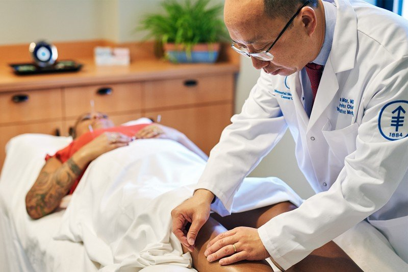 Memorial Sloan Kettering Chief of Integrative Medicine Service and acupuncture specialist Jun Mao with a patient