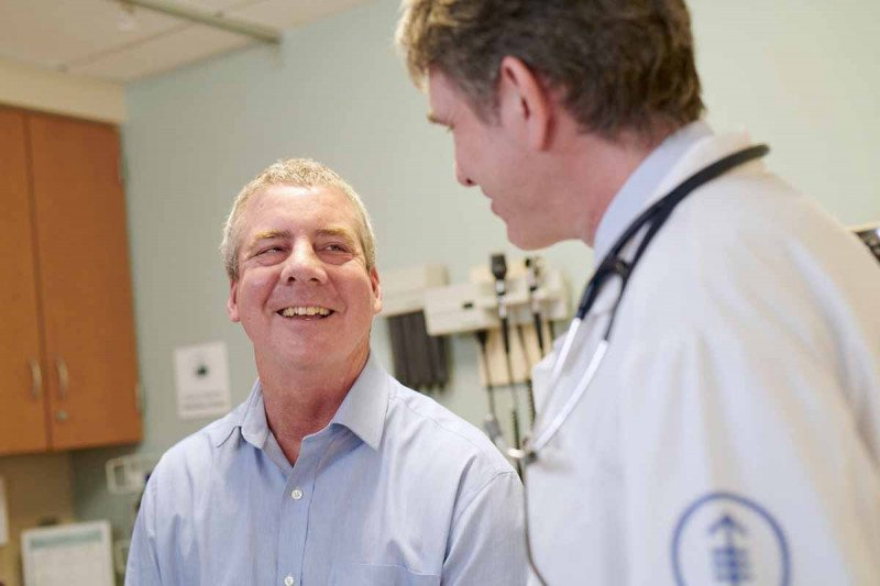A leukemia patient meets with their doctor