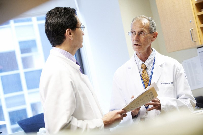 Medical oncologists Leonard Saltz (left) and David Paul Kelsen discuss a patient's treatment.