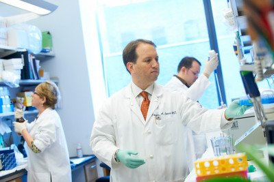 Gynecologic oncologist Douglas Levine in his lab .